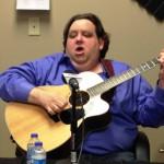 Joey plays guitar on Business RadioX