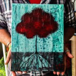 artist-holding-tree-pic